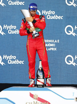 Lucas di Grassi, ABT Schaeffler Audi Sport, with his trophy on the podium