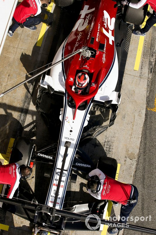 Kimi Raikkonen, Alfa Romeo Racing, stops in his pit area