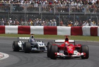 Michael Schumacher, Ferrari F2004 leads Juan Pablo Montoya, Williams BMW FW26