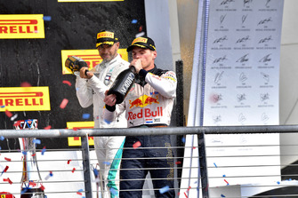 Lewis Hamilton, Mercedes AMG F1 and Max Verstappen, Red Bull Racing celebrate with the champagne on the podium