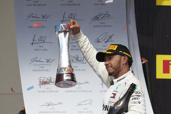 Lewis Hamilton, Mercedes AMG F1, 3rd position, on the podium with his trophy and Champagne