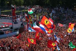 Sebastian Vettel, Ferrari celebrates on the podium, the Ferrari fans and flags