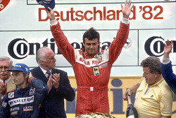 Rene Arnoux, Renault RE30B, 2nd position, and Patrick Tambay, Ferrari 126C2, 1st position, podium