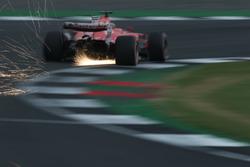 Sparks fly from Sebastian Vettel, Ferrari SF70H