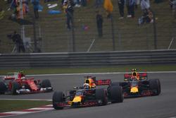 Daniel Ricciardo, Red Bull Racing RB13, leads Max Verstappen, Red Bull Racing RB13, and Kimi Raikkonen, Ferrari SF70H
