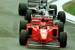 Michael Schumacher, Ferrari F310B; Heinz-Harald Frentzen, Williams FW19, Renault