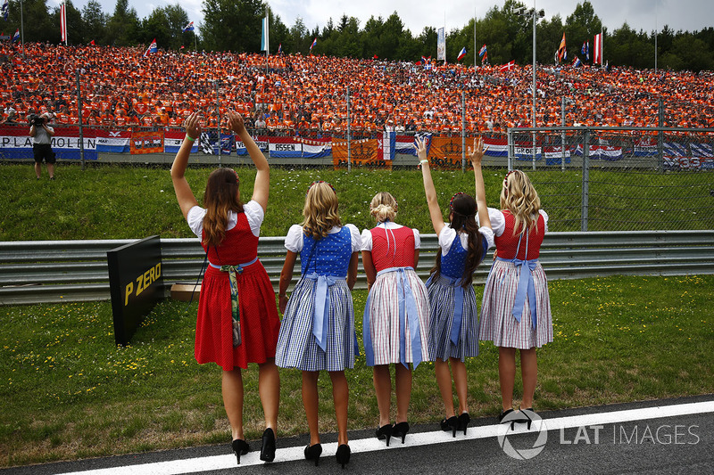 Austrian promotional girls wave to fans