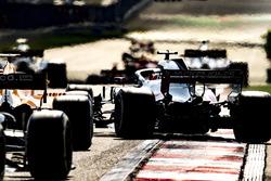 Romain Grosjean, Haas F1 Team VF-18 Ferrari, pulls across ahead of Fernando Alonso, McLaren MCL33 Renault