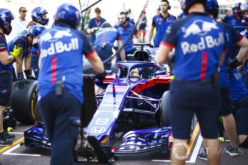 The Toro Rosso team undertake pit stop practice