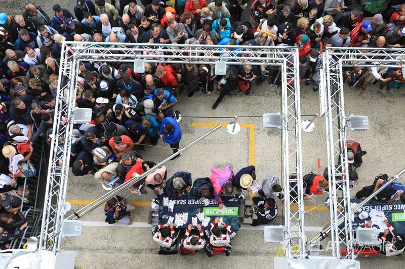 Fans surround the Toyota Gazoo Racing autograph table