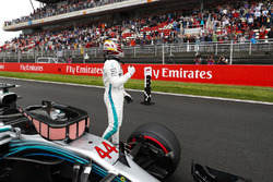 Pole winner Lewis Hamilton, Mercedes AMG F1, acknowledges fans after qualifying
