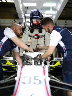 Sergey Sirotkin, Williams Racing, settles into his car