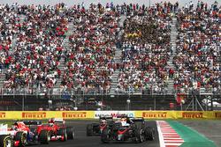 Alexander Rossi, Manor Marussia MR03, leads Kimi Raikkonen, Ferrari SF-15T, Fernando Alonso, McLaren MP4-30, Jenson Button, McLaren MP4-30, and Will Stevens, Manor Marussia MR03