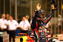 Sebastian Vettel, Red Bull Racing RB7 Renault, celebrates pole in Parc Ferme