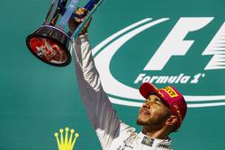 Race winner Lewis Hamilton, Mercedes AMG F1, lifts his trophy