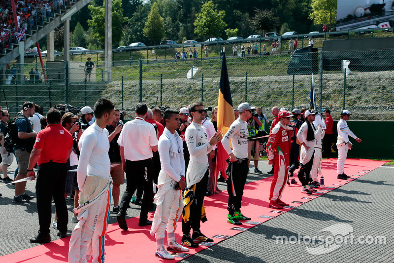 Drivers as the grid observes the national anthem