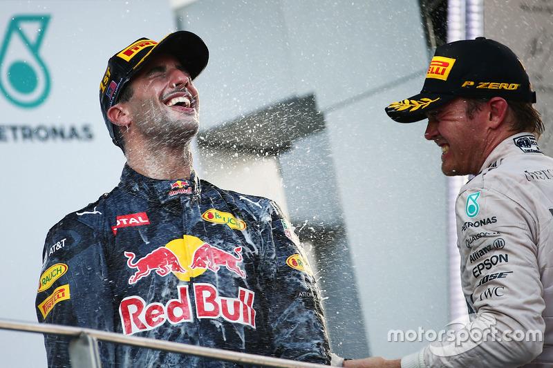 Race winner Daniel Ricciardo, Red Bull Racing celebrates on the podium with third placed Nico Rosberg, Mercedes AMG F1