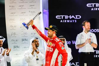 Sebastian Vettel, Ferrari, 2nd position, lifts his trophy