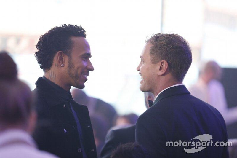 Sebastian Vettel, Ferrari com Lewis Hamilton, Mercedes-AMG F1