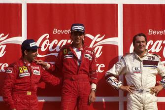Podium: winner Gerhard Berger, Ferrari, second place Michele Alboreto, Ferrari F187, third place Eddie Cheever, Arrows