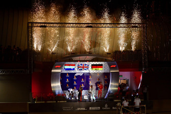 (L to R): Max Verstappen, Red Bull Racing, Lewis Hamilton, Mercedes AMG F1 and Sebastian Vettel, Ferrari celebrate on the podium with the champagne