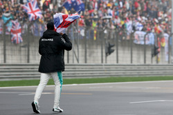 Lewis Hamilton, Mercedes AMG, takes to the track to entertain the fans and picks up a Union Flag