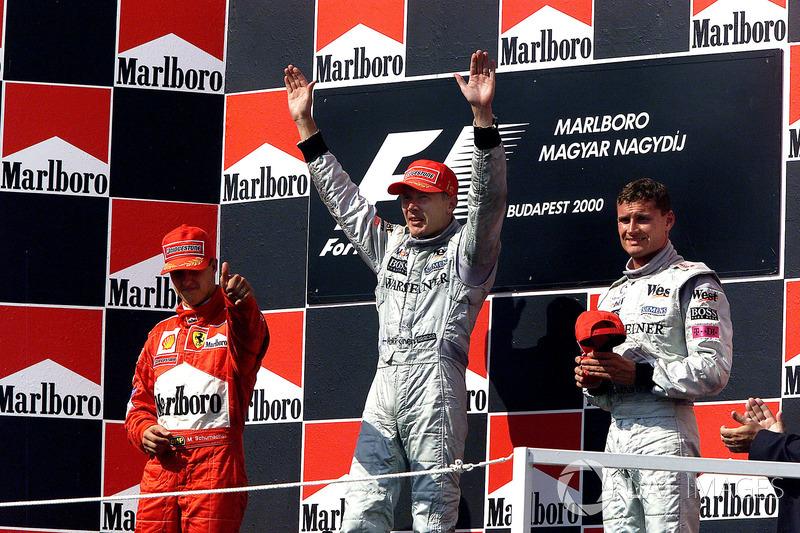 Podyum: Yarış galibi Mika Hakkinen, McLaren, 2. Michael Schumacher, Ferrari, 3. David Coulthard, McLaren