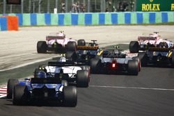 Esteban Ocon, Sahara Force India F1 VJM10, runs wide battling Sergio Perez, Sahara Force India F1 VJM10. Jolyon Palmer, Renault Sport F1 Team RS17, follows ahead of Nico Hulkenberg, Renault Sport F1 Team RS17
