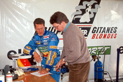 Michael Schumacher and Benetton technical director Ross Brawn evaluate the performance of the Ligier JS39B and the Renault V10 engine