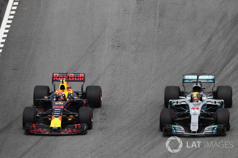 Max Verstappen, Red Bull Racing RB13, passes Lewis Hamilton, Mercedes AMG F1 W08, for the lead