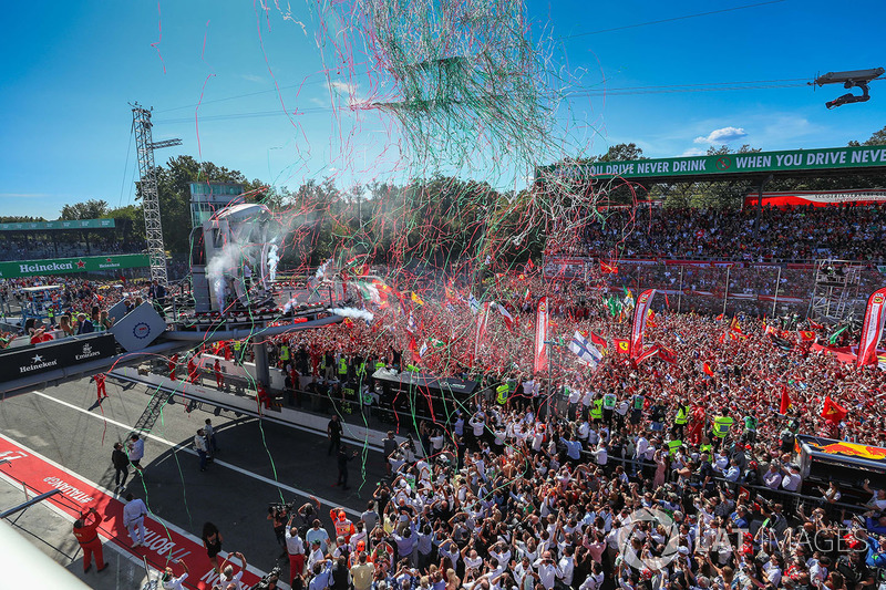 Sebastian Vettel, Ferrari, Lewis Hamilton, Mercedes AMG F1 and Valtteri Bottas, Mercedes AMG F1 celebrate on the podium and Ferrari Fans and flags at the podium celebrations