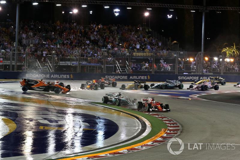 Sebastian Vettel, Ferrari SF70H leads at the start of the race as Fernando Alonso, McLaren MCL32, Kimi Raikkonen, Ferrari SF70H and Max Verstappen, Red Bull Racing RB13 crash in the background