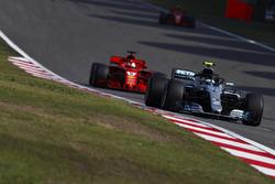 Valtteri Bottas, Mercedes AMG F1 W09, leads Sebastian Vettel, Ferrari SF71H, and Kimi Raikkonen, Ferrari SF71H