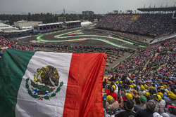 Fernando Alonso, McLaren MCL32 and fans in the grandstand with a Mexican flag