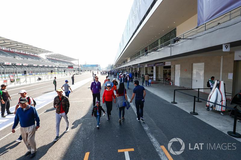 Fans walking through the pitlane
