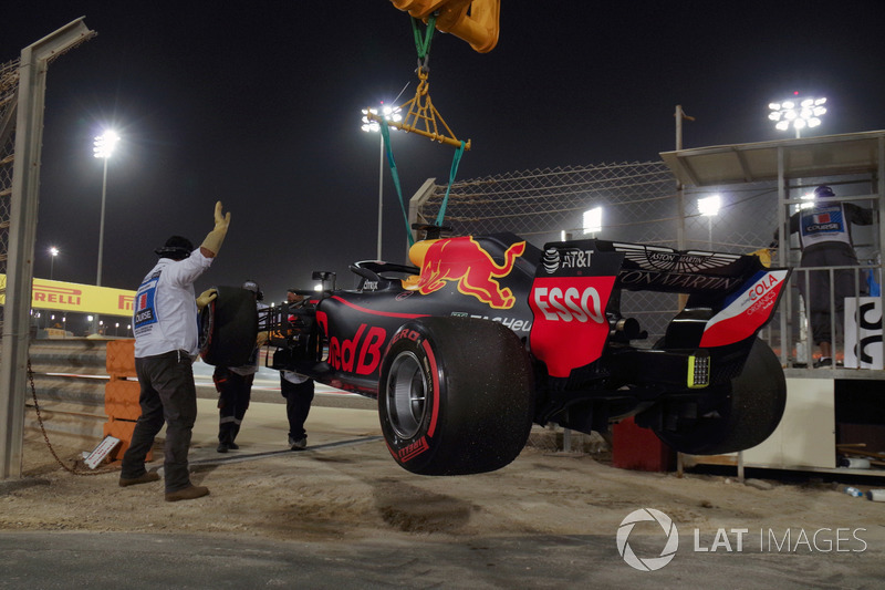 The car of race retiree Daniel Ricciardo, Red Bull Racing RB14 is recovered