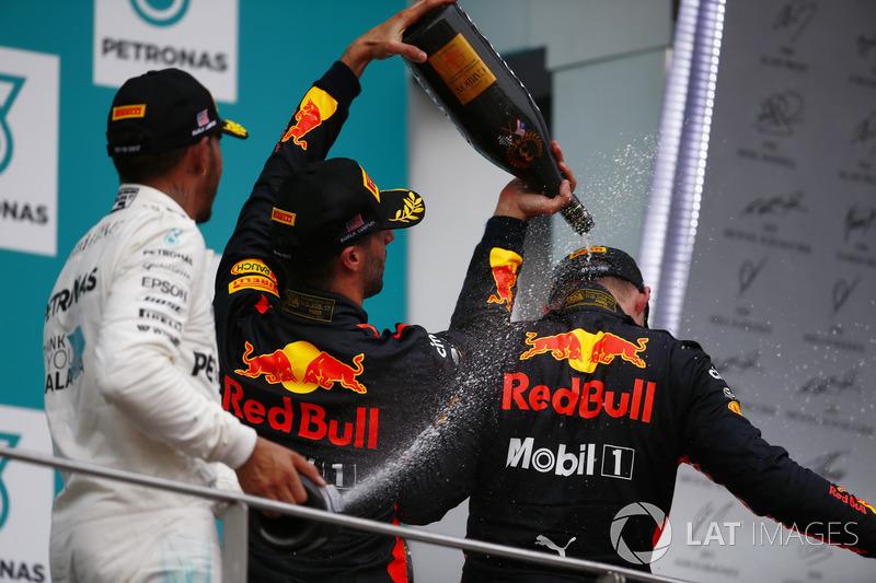 Lewis Hamilton, Mercedes AMG F1, Daniel Ricciardo, Red Bull Racing, spray champagne over winner Max Verstappen, Red Bull Racing, on the podium