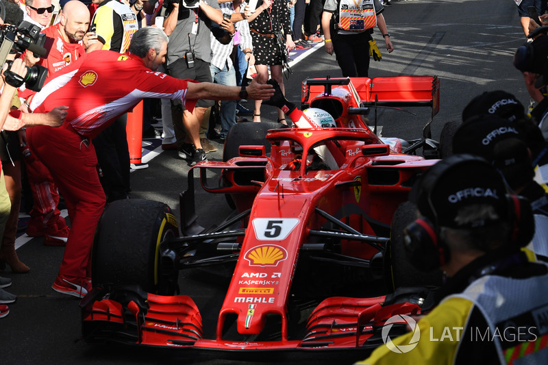Race winner Sebastian Vettel, Ferrari SF71H celebrates in parc ferme with Maurizio Arrivabene, Ferrari Team Principal