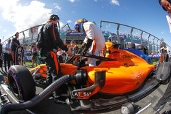 Fernando Alonso, McLaren MCL33 Renault, climbs out of his car on the grid
