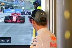 Max Verstappen, Red Bull Racing watches the garage TV
