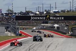 Sebastian Vettel, Ferrari SF70H, Lewis Hamilton, Mercedes AMG F1 W08, and Valtteri Bottas, Mercedes AMG F1 W08, on the first lap of the race