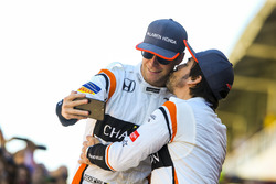 Fernando Alonso, McLaren, kisses Stoffel Vandoorne, McLaren, for a joke photo