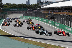 Valtteri Bottas, Mercedes-Benz F1 W08 and Sebastian Vettel, Ferrari SF70H battle at the start of th