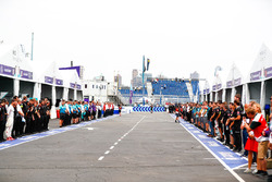 Teams gather in the pit lane