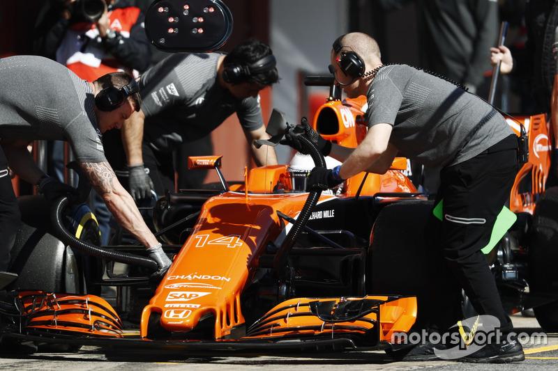McLaren mechanics at work on the Fernando Alonso McLaren MCL32