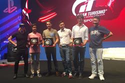 Dani Clos, Albert Costa, Dani Juncadella, Miguel Molina y Lucas Ordóñez son premiados de manos de Kazunori Yamauchi tras probar el GT Sport en el Barcelona Games World
