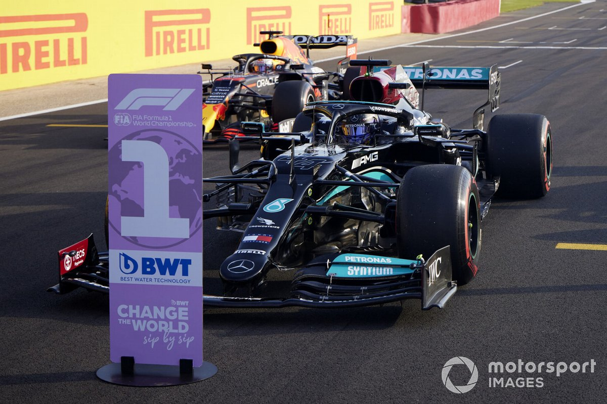 Pole man Lewis Hamilton, Mercedes W12, and Max Verstappen, Red Bull Racing RB16B, arrive in Parc Ferme after Qualifying