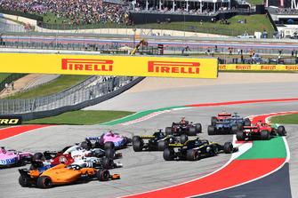 Sebastian Vettel, Ferrari SF71H runs wide at the start of the race