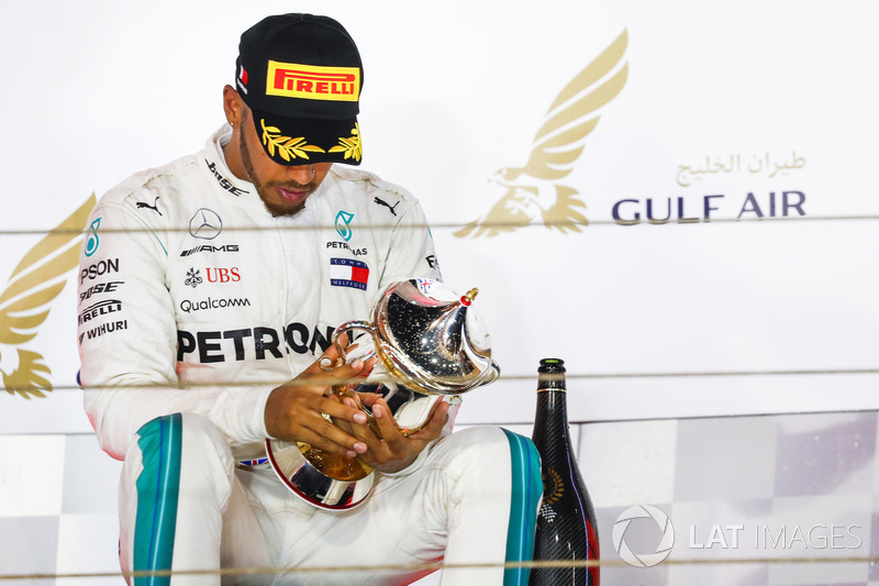 Lewis Hamilton, Mercedes AMG F1, 3rd position, inspects his trophy on the podium