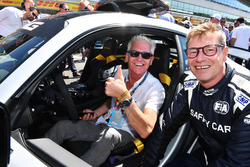 Bernd Maylander, FIA Safety Car Driver and Philip Schofield, on the grid